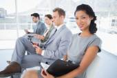 Business people sitting and waiting — Stock Photo
