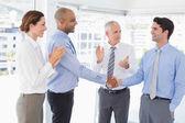 Business team congratulating their colleague — Stock Photo