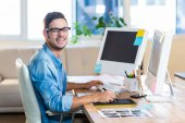 Casual businessman using digitizer at his desk — Stock Photo