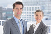 Business colleagues smiling at camera — Stock fotografie