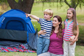 Mother and children having fun in the park — Stock Photo