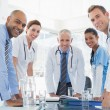 Team of smiling doctors having meeting — Stock Photo #76210843