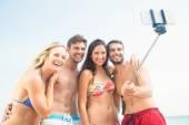 Friends taking selfie at beach — Stock Photo