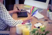 Interior designer working at desk — Stock Photo