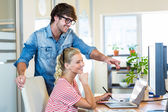 Smiling team working with digitizer and laptop — Stock Photo