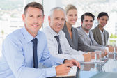 Business team smiling at camera during conference — Stock Photo