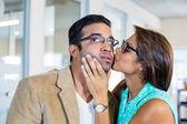 Beautiful brunette kissing her boyfriend — Stock Photo