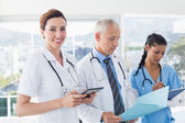 Doctors working together on patients file — Stock Photo