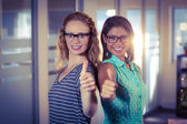 Happy designers showing thumbs up — Stock Photo