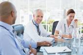 Team of smiling doctors having a meeting — Stock Photo