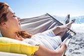 Brunette relaxing in the hammock — Stock Photo