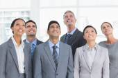 Business people looking up in office — Stock Photo