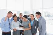 Business team celebrating a new contract — Stock Photo