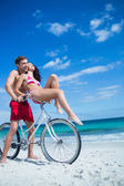 Happy couple going on a bike ride — Stock Photo