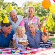 Happy family celebrating a birthday — Stock Photo #76342857