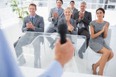 Business team applauding during conference — Stock Photo