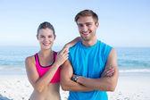 Happy couple smiling at camera — Stock Photo