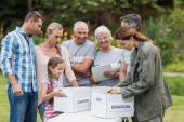 Happy volunteer family separating donations stuffs — Stock Photo