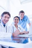 Team of doctors smiling at camera — Stock Photo