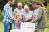 Happy volunteer family separating donations stuffs — Stock Photo