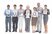 Business people holding sign — Stock Photo
