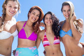 Beautiful women standing together arm around — Stock Photo