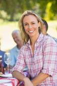 Woman smiling during picnic — Stock Photo