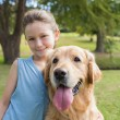Little girl with her dog in the park — Stock Photo #76352513