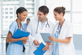 Portrait of doctors with arms crossed — Stock Photo