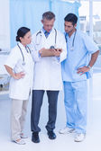 Portrait of confident doctors with arms crossed — Stock Photo