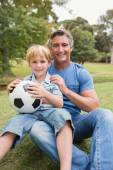 Happy father with his son at the park — Stock Photo