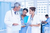 Male and female doctors working on reports — Stock Photo
