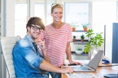 Smiling colleagues looking at camera — Stock Photo