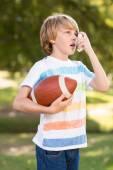 Little boy using his inhaler — Stock Photo