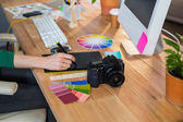Designer working with colour wheel and digitizer — Stock Photo