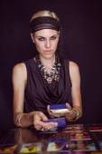 Fortune teller forecasting the future with tarot cards — Stock Photo