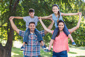 Family in the park together — Stock Photo
