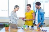 Casual business team discussing about colour chart — Stock Photo