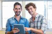 Business team looking at tablet — Stock Photo