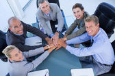 Employees putting hands together — Stock Photo