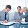 Businesswoman whispering something to colleague — Stock Photo #76424909