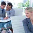 Businesswoman whispering something to colleague — Stock Photo #76425885