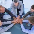Employees putting hands together — Stock Photo #76426861