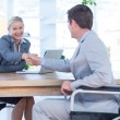 Businesswoman interviewing disabled job candidate — Stock Photo #76427517