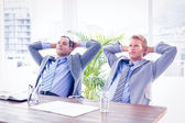 Businessmen relaxing at work — Stock Photo