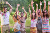 Happy friends covered in powder paint — Stock Photo