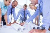 Business people looking at construction plan — Stock Photo