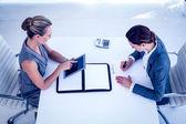 Businesswomen working together at desk — Stock Photo
