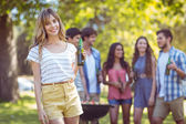 Happy friends in the park having barbecue — Stock Photo