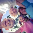 Smiling children looking down the camera — Stock Photo #76433749